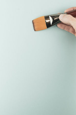 paintbrush - art and craft Art And Craft Paint Brush Adult Blue Background Body Part Close-up Colored Background Copy Space Creativity Finger Gray Gray Background Hand Holding Human Body Part Human Hand Indoors  Men One Person Painting Shiny Silver Colored Single Object Studio Shot White Background
