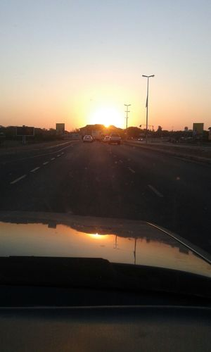 Beautiful Sunset Driving Sillouette No Filter best part of the pic is the reflection on the car bonnet..:-)