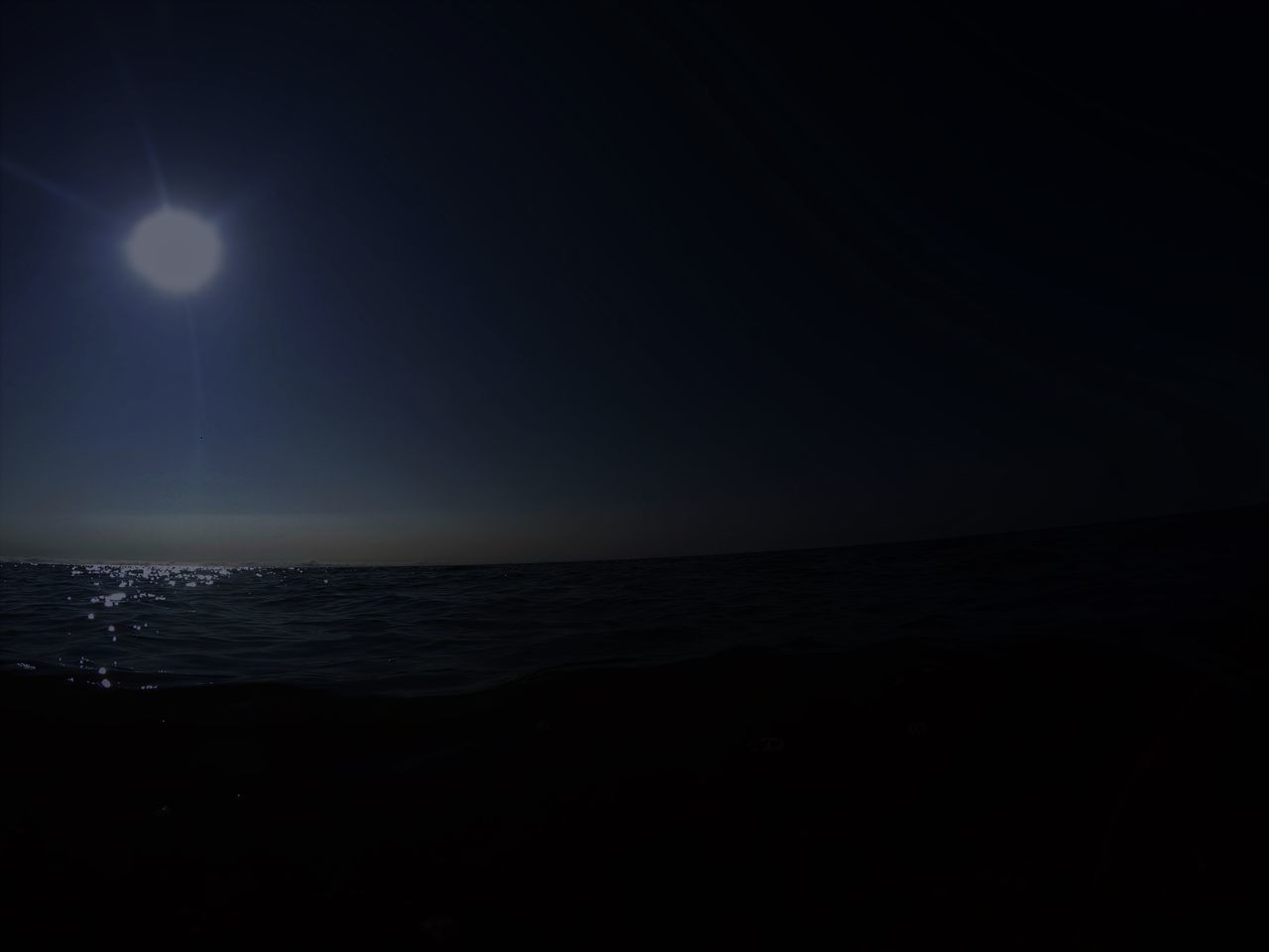 sea, tranquil scene, scenics, tranquility, beauty in nature, nature, horizon over water, water, moon, idyllic, silhouette, night, beach, outdoors, sky, moonlight, no people, clear sky, astronomy