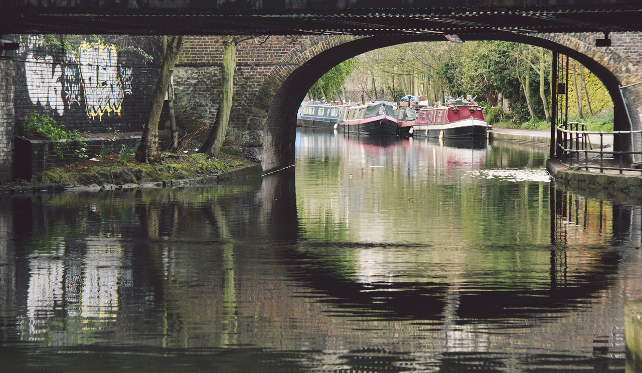 Boats In Canal Seen Through Arch
