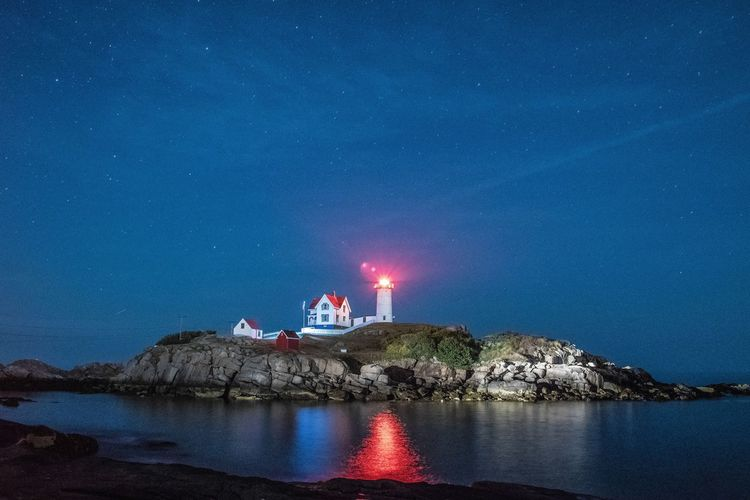 Travel Nubble Lighthouse York, Maine Lighthouse Water Nature Lighthouse Waterfront Landscape_Collection Landscape EyeEm Best Shots EyeEm Nature Lover Night Stars Nightphotography Night Lights Ocean Seascape Seaside Tranquility Night Photography Sea Nature Nature_collection Beach