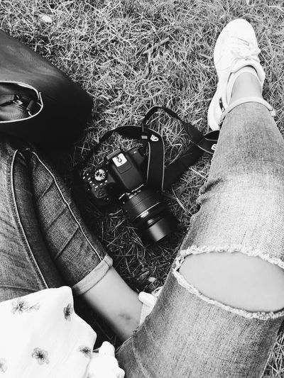 Black And White Friday High Angle View Real People Day Human Leg Weapon Outdoors One Person Human Body Part Technology Low Section Close-up Digital Single-lens Reflex Camera Human Hand People