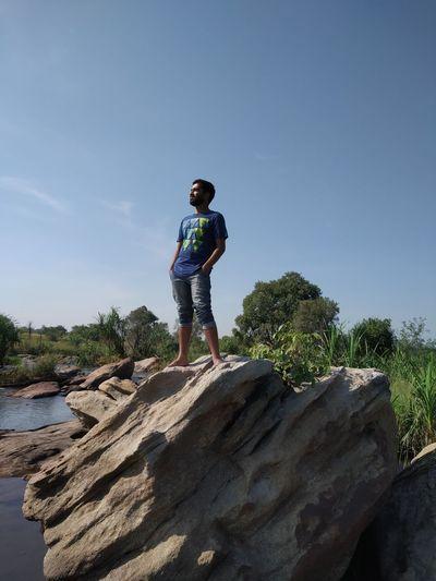 boy on stone Full Length Standing Sky Casual Clothing Beach Umbrella Lifeguard Hut Wave Surfer Coast Calm Sand