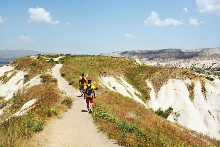 Tourists on mountain landscape
