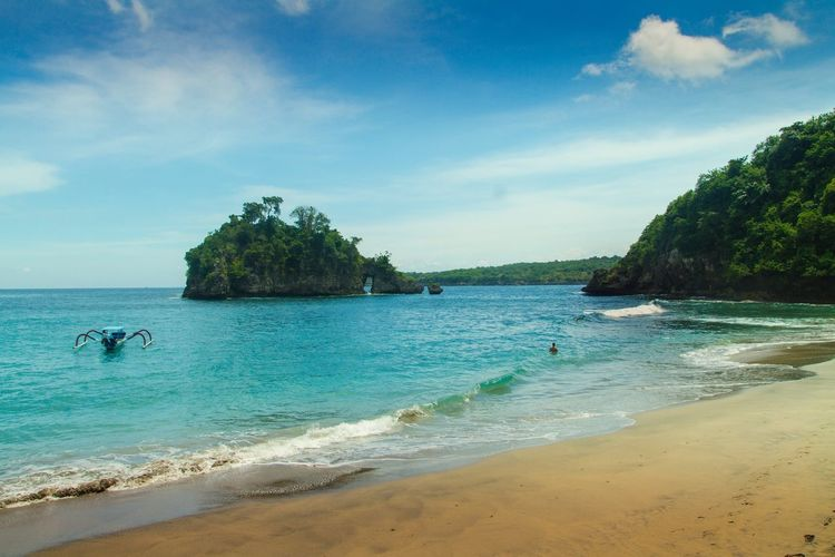 NUSA PENIDA Sea Beach Water Nature Sand Sky Beauty In Nature Cloud - Sky Vacations Travel Photography Bali Island Sea And Sky Adventure Cliff Rock - Object Landscape_photography Beachphotography Seascape Beach Day Nusapenida Beauty In Nature Outdoors Landscape Boat Shore