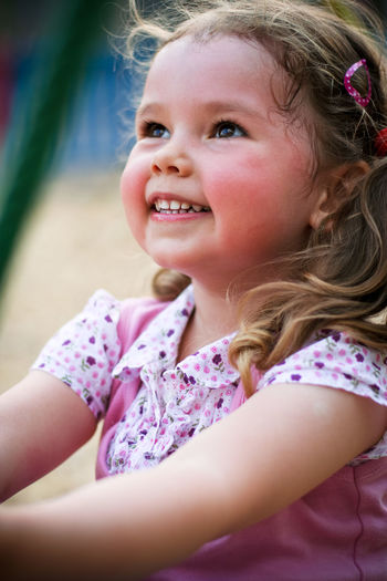 Child Childhood Girls Innocence Women Females Cute Real People Portrait One Person Lifestyles Looking Casual Clothing Leisure Activity Looking Away Close-up Day Hairstyle Floral Pattern Smiling Happy Pink