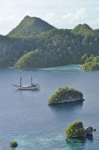 Raja Ampat INDONESIA Adventures Beauty In Nature Indonesia Photography  Phinisi Boat Raja Ampat Water Mountain Lake Sky