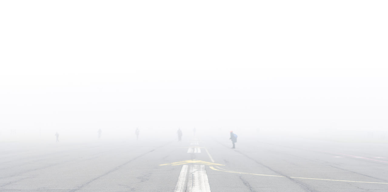 full length, walking, the way forward, day, fog, real people, outdoors, nature, road, winter, men, two people, cold temperature, beauty in nature, people, adult