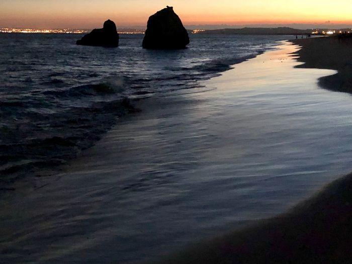 Beach Water Sea Beauty In Nature Sky Beach Sunset Scenics - Nature Land Tranquility Tranquil Scene Nature Horizon No People Horizon Over Water Silhouette Idyllic Dusk Outdoors Rock
