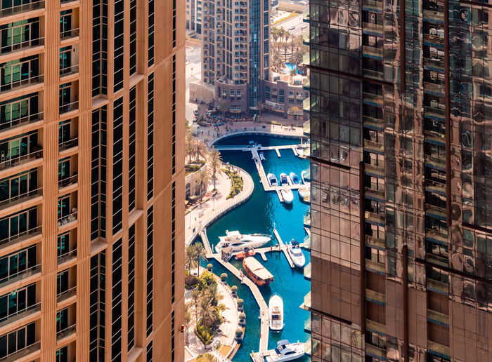 High angle view of harbor seen through buildings in city