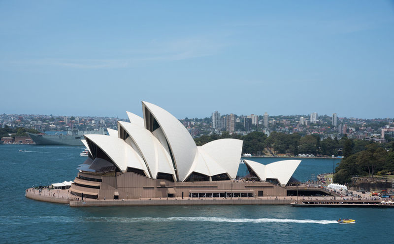 Sydney,NSW,Australia-November 20,2016: Elevated view over the Sydney Opera House at Bennelong Point in Sydney, Australia 20th Century Architecture Australia Cityscape Harbour Roof Sydney Cove Sydney Opera House Tourist Tourist Attraction  Tourists Transportation Venue Arts Culture And Entertainment Bennelong Point Boat Building Exterior Elevated View Expressionist Landmark Nautical Vessel Sydney Travel Destinations Wake Water