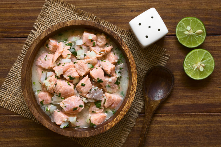 Chilean salmon ceviche prepared with onion, garlic, fresh coriander, salt and lemon juice, photographed overhead with natural light (Selective Focus, Focus on the top of the ceviche) Chile Chilean  Herb Homemade Homemade Food Meal Raw Snack Appetizer Cebiche Ceviche Chilean Food Cilantro Coriander Fish Food Food And Drink Fresh Lemon Lemon Juice Onion Raw Food Salmon Seafood Uncooked