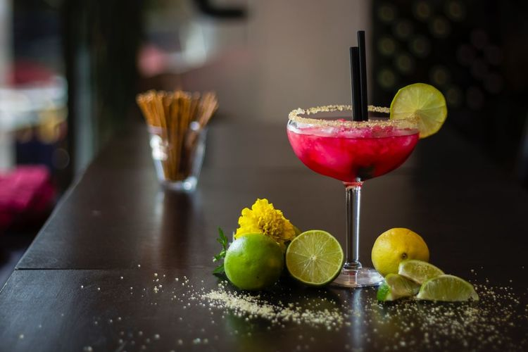 Cocktail with cinnamon and lime