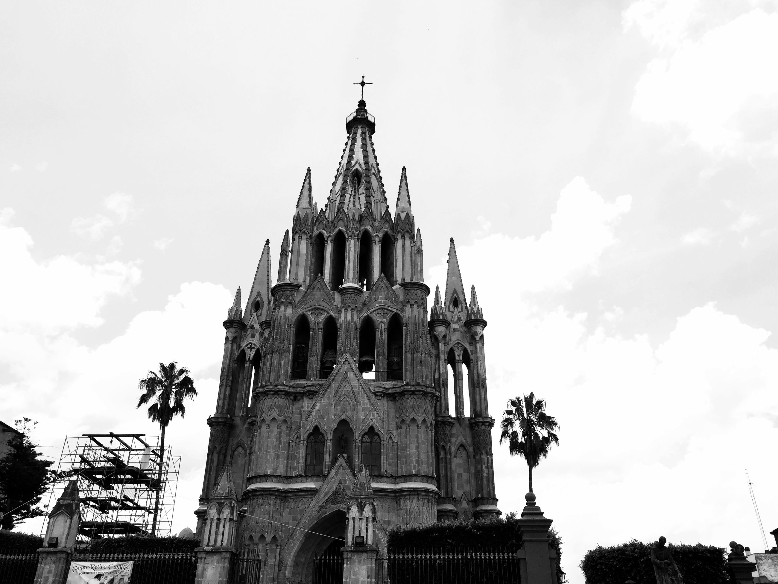 religion, place of worship, architecture, spirituality, building exterior, built structure, church, low angle view, sky, cathedral, history, cross, steeple, old, travel destinations, famous place, day, cloud - sky
