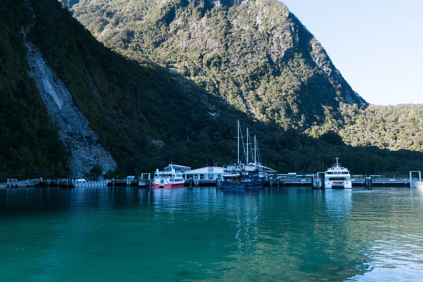 Milford Sound Beauty In Nature Day Lake Mode Of Transport Moored Mountain Mountain Range Nature Nautical Vessel New Zealand No People Outdoors Reflection Scenics Sky Tranquil Scene Tranquility Transportation Water Waterfront