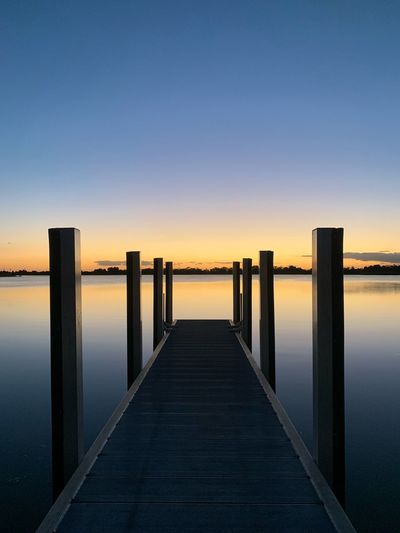 EyeEm Selects Sky Water Sunset Scenics - Nature Sea Tranquil Scene Beauty In Nature Tranquility Nature No People Pier Clear Sky Idyllic Blue Architecture Built Structure Copy Space The Way Forward Outdoors Wooden Post