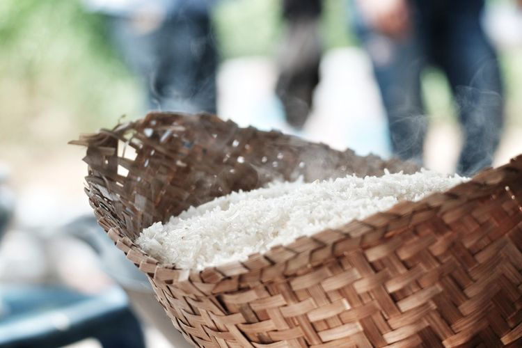 Close-Up Of Cooked Rice In Wicker Basket