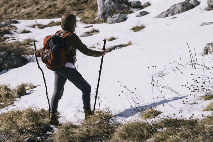 Hiking on the mountain Rtanj, Serbia Adult Adventure Backpack Day Full Length Hiking Hiking Pole Leisure Activity Nature One Person Outdoors Real People Snow Winter Woman