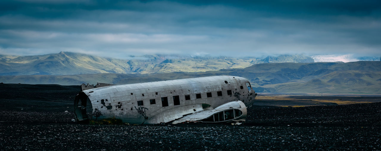 The wrecked DC-3 in the South of Iceland. Iceland Abandoned Air Vehicle Airplane Beauty In Nature Cloud - Sky Cold Temperature Crash Damaged Day Destruction Landscape Military Airplane Mode Of Transport Mountain Mountain Range Nature No People Outdoors Scenics Sky Transportation Travel Travel Destinations Weather