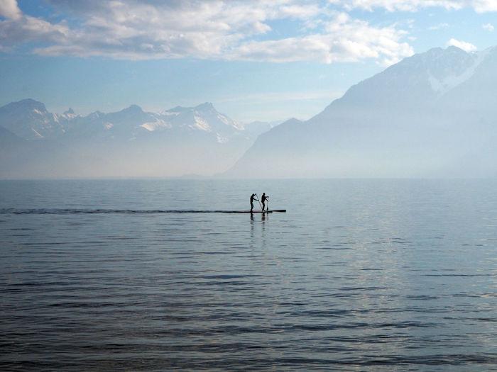 People paddleboarding in lake geneva