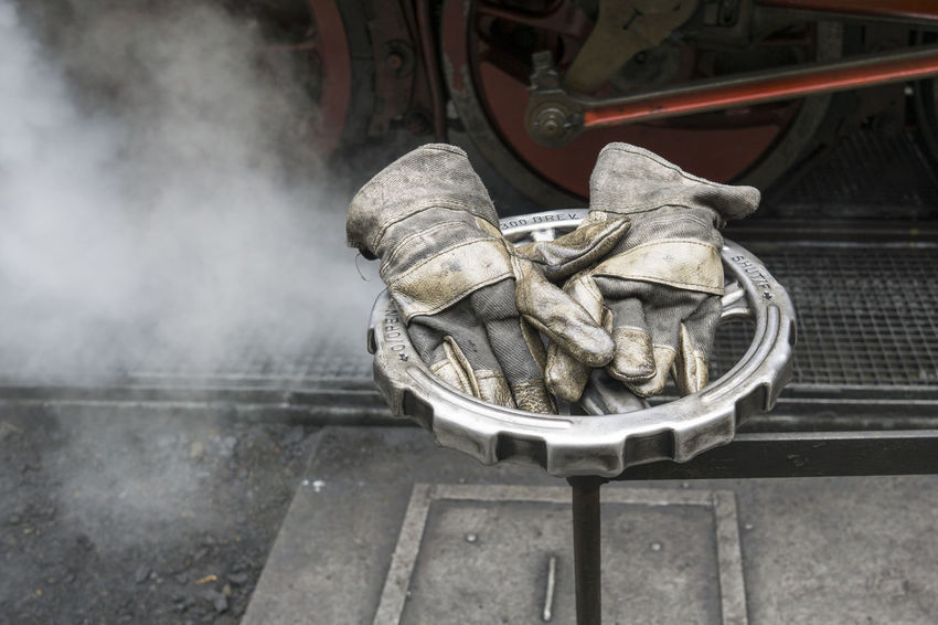 image of well worn leather work gloves on shut-off valve. Steam from a steam locomotive in the background Close-up Day Focus On Foreground Leather No People Outdoors Well Worn Work Gloves