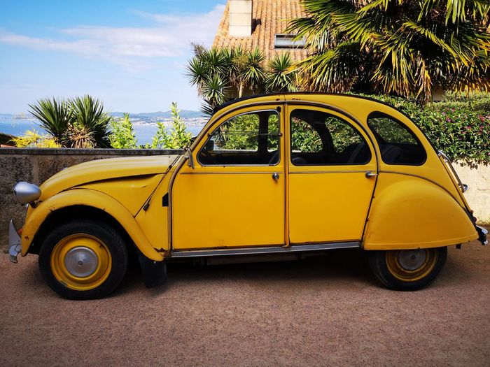 Yellow Car Sea Sea And Sky Blue Wheel SPAIN Galicia Galicia, Spain EyeEm Gallery Eyemphotography City Colors Streetphotography Yellow Taxi Collector's Car Retro Styled Taxi Vintage Car Vintage Antique