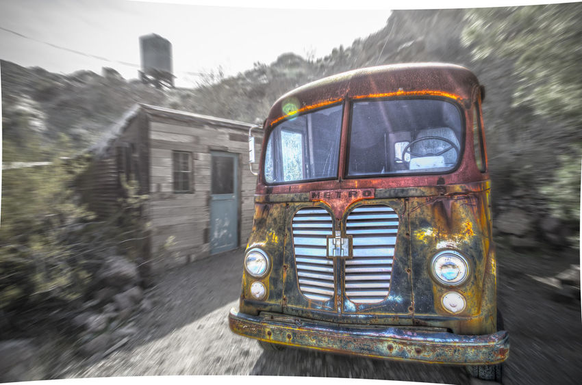 Riding on the Metro - a 1954 IH Metro van abandoned at an old gold mine in Nevada. Abandoned Close-up Day Ghost Town History International Harvester Lens Flare Sun Mine No People Old Outdoors Road Transportation Truck Van