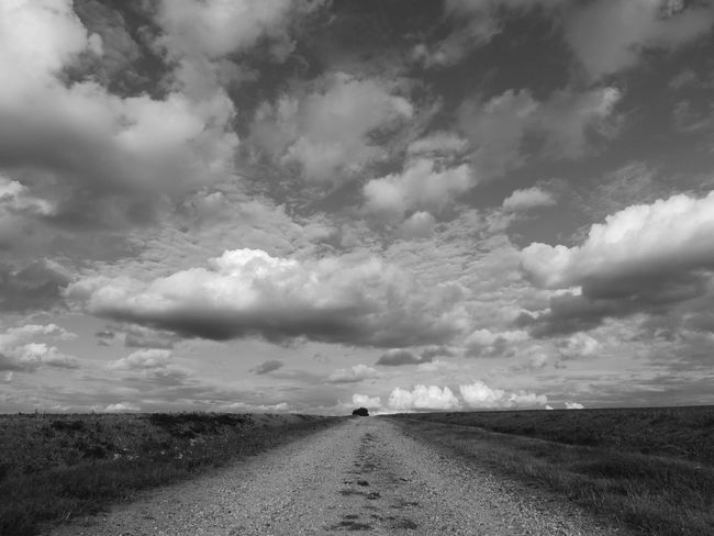 France Loire Touraine Beauty In Nature Cloud - Sky Diminishing Perspective Direction Dirt Road Environment Field Horizon Over Land Land Landscape Nature No People Non-urban Scene Ominous Outdoors Road Scenics - Nature Sky The Way Forward Tranquil Scene Tranquility Transportation