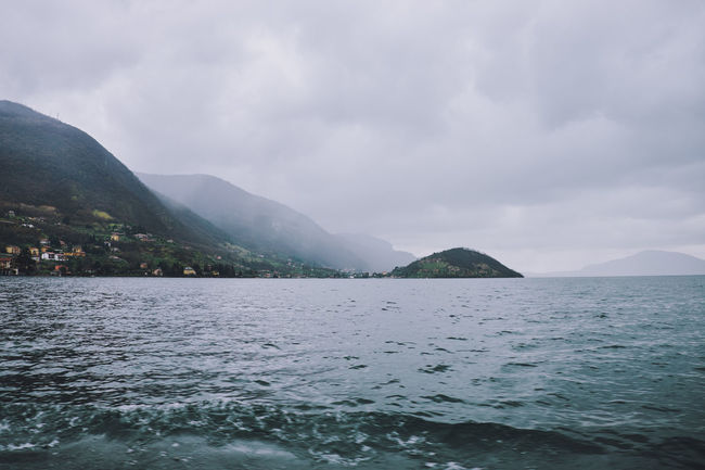 View from the ferry to Monte Isola on a rainy day. Ferry Italy 🇮🇹 Lake Iseo (italy) Monte Isola Beauty In Nature Cloud - Sky Idyllic Italy🇮🇹 Lake Lake View Mountain Nature No People Non-urban Scene Outdoors Real People Scenics - Nature Sea Sky Tranquil Scene Tranquility Water Waterfront