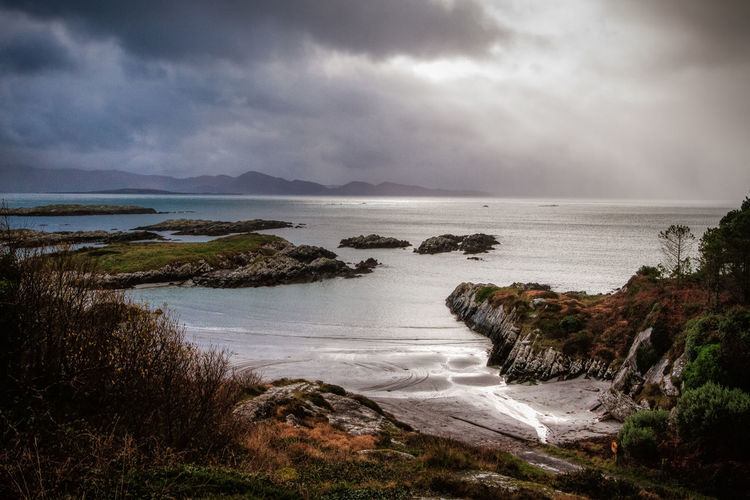 The Irish Ring of Kerry - A winter storm rolls in along the Irish Ring of Kerry. Beauty In Nature Cloud - Sky Day Grass Horizon Over Water Ireland Landscape Nature No People Outdoors Ring Of Kerry Scenery Scenics Sea Sea And Sky Sky Storm Tranquil Scene Tranquility Travel Water Winter