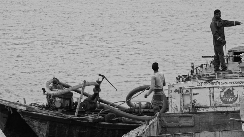 MEN AT WORK Boat Day Fisherman Men Mode Of Transport Nature Nautical Vessel Occupation Outdoors People Real People Sailing Sea Sitting Teamwork Transportation Water Working