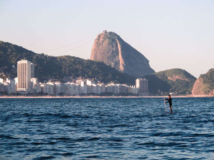 Standup Paddle at Copacabana beach, Sugar Loaf Mountain at the bottomRio de Janeiro Beauty In Nature Copacabana Copacabana - Rio De Janeiro Copacabana Beach EyeEm Best Shots EyeEm Nature Lover EyeEmBestPics Lifestyles Men Mountain Nature One Person Real People Rio De Janeiro Brasil Photos Official EyeEm © Rio De Janeiro Eyeem Fotos Collection⛵ Riodejaneiro Scenics Sea Standup Standup Paddleboarding Standuppaddle StandupPaddleBoard Standuppaddleboarding Sugarloaf Water