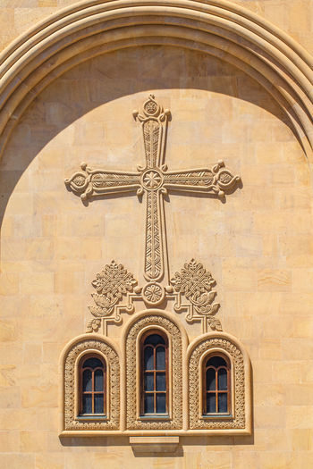 Low angle view of cross pattern on church wall