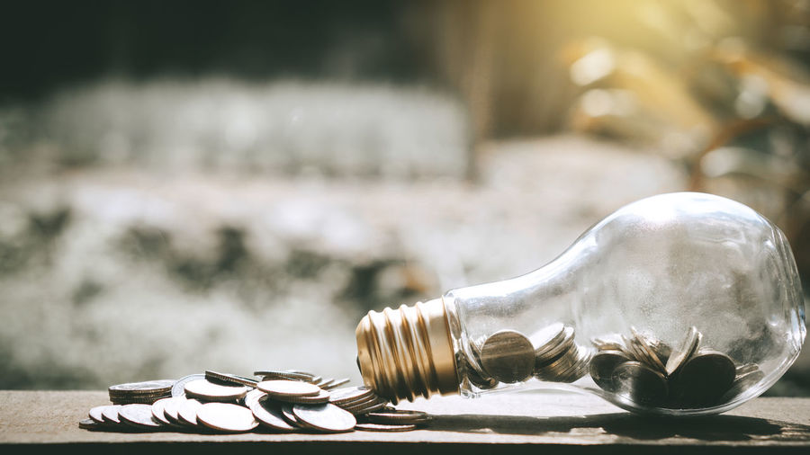 Close-up of coins in light bulb
