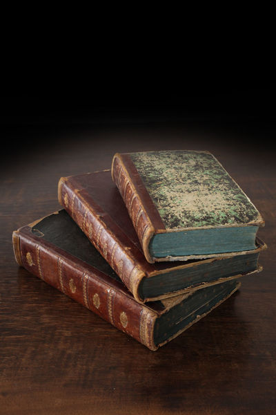 old books piled on a wooden table Antique Books Bookshelf Bookshelfs Learning Library Read Reading Book Close Up Collection Cover Culture Indoors  No People Old Piled Reading A Book Traditional Wood - Material