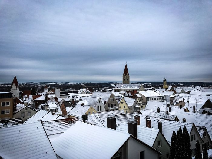 Houses against sky during winter