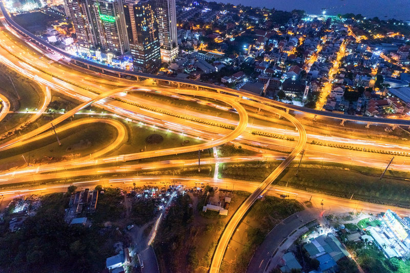 High angle view of illuminated roads and bridges in city at night