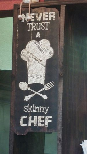 Burger joint humor Never Trust A Skinny Chef Sign In Burger Joint Sign Porn Humor Chef Hat Spoon And Fork Coat Of Arms Full Belly Burgers Lakewood Ranch Florida