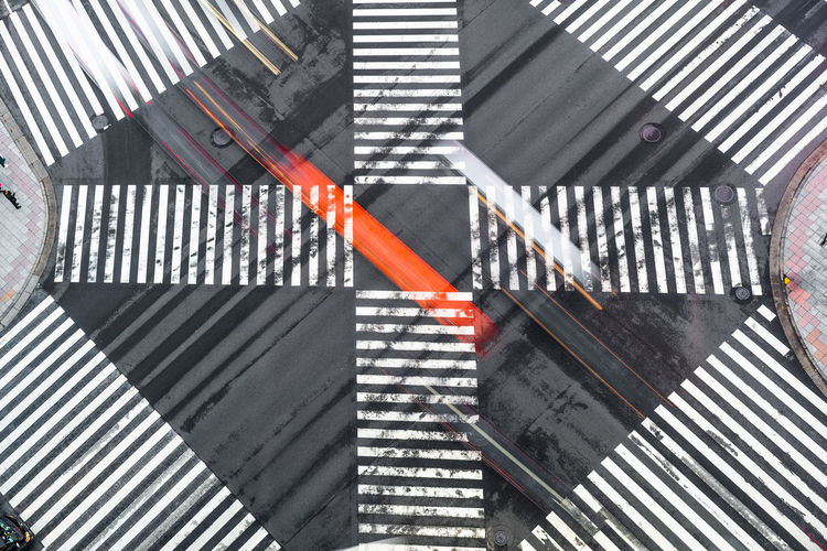 High angle view of crossing sign on road