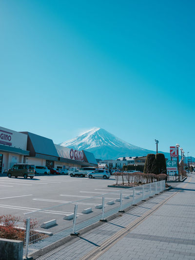 Sky Mountain Clear Sky Snow Winter Copy Space Cold Temperature Blue Architecture Nature Day Snowcapped Mountain Built Structure Building Exterior Transportation Incidental People Beauty In Nature Travel Destinations Mountain Peak