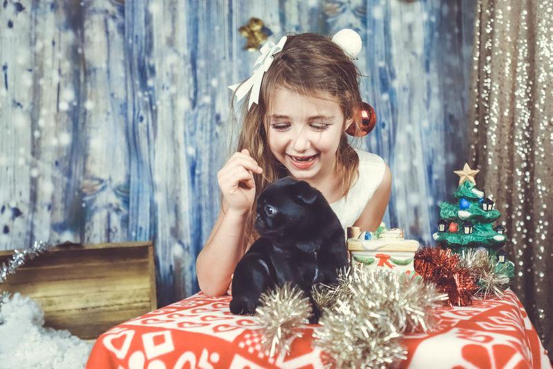 Portrait of happy girl on christmas tree