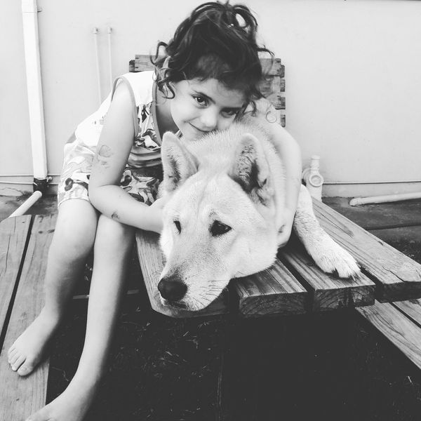Lea and Gizmo the wolf dog . One Person One Girl Only People Childhood Sitting Children Only Child Day Portrait Real People Outdoors Pets Animal Themes Friendship Love Embracing Affectionate Bonding Cute Lifestyles Happiness Beautiful Woman Beauty Confidence  Smiling EyeEmNewHere