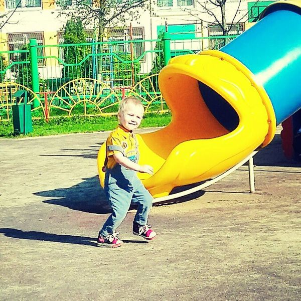 Childhood Playground Full Length One Person Innocence Fun Blond Hair Child Children Only Happiness Leisure Activity People Yellow Outdoors Day One Boy Only Baby Smiling Portrait Slide - Play Equipment