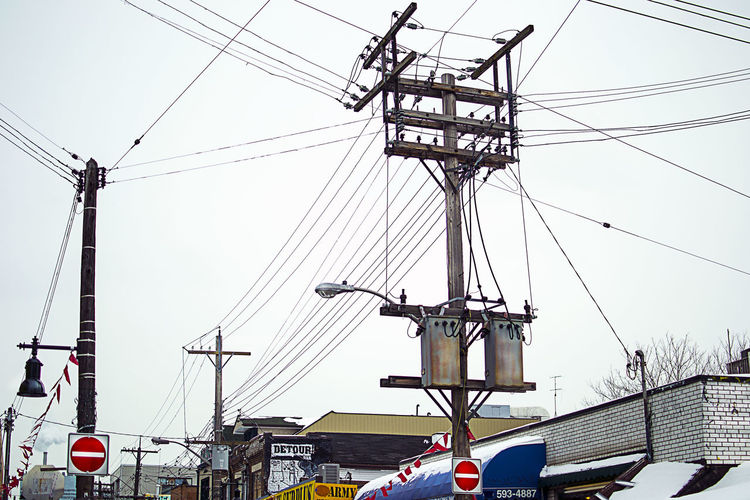 Architecture Building Exterior Built Structure Cable City City Life Clear Sky Construction Construction Site Day Development Electricity  Electricity Pylon Engineering Low Angle View Outdoors Power Line  Power Supply Progress Road Sign Sky Street Light Tall - High Tower Travel Destinations