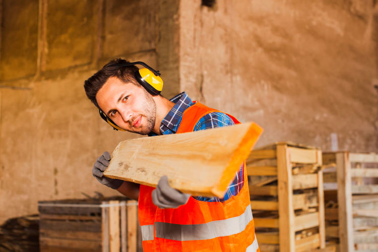Portrait of man working at construction site