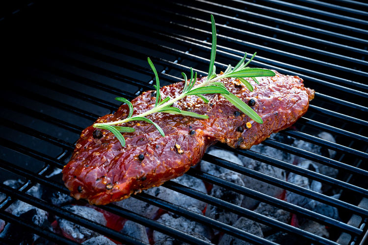 BBQ Beef Steak On Grill With Rosemary Pepper And Salt - Barbecue Barbecue Barbecue Grill Grilled Meat Food Food And Drink Heat - Temperature Freshness No People Preparation  Red Meat High Angle View Metal Meal Close-up Fire Grate Flame Beef Metal Grate Dinner Herb BBQ Beef Steak Grill