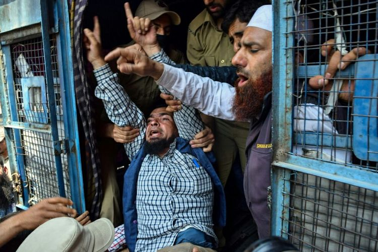Indian policemen manhandle a physically disabled person while shouting slogans to press government for their demands during a protest in Srinagar on Ma 10,2016, the summer capital of Kashmir. The protesters demands included reservation in jobs, financial assistance, concession in water and electricity tariff and many other demands. The Photojournalist - 2016 EyeEm Awards Welcomeweekly ASIA Popular Storyteller Photooftheday Srinagar  Humanity Lost Magazine Photojournalist Hello World EyeEm Best Shots Handicapped Rights Justice Press Photography News The Photojournalist 2016 Finalists