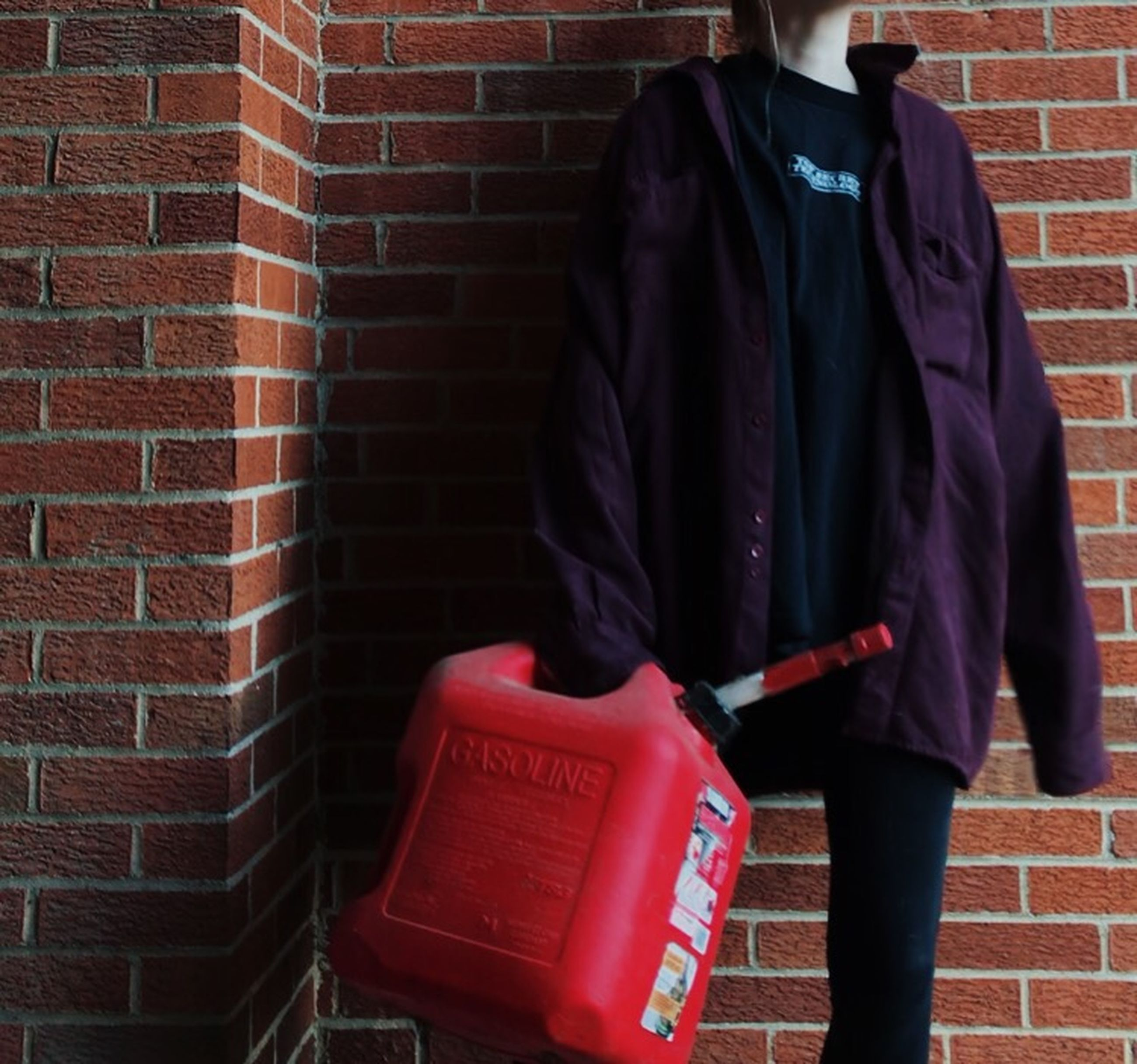 brick, brick wall, wall, one person, wall - building feature, real people, standing, red, day, text, clothing, men, bag, architecture, three quarter length, rear view, walking, lifestyles, holding, outdoors