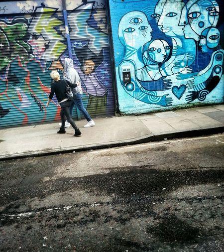 Woman walking on sidewalk