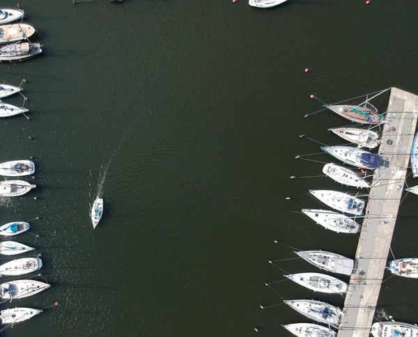 Sail boat on the marina Gdansk River Sailing Ship Sailboat Marina Harbour View Fromabove Birdeyeview. Coastline River View Tourism Tourists From Above  Baltic Coast Sailing Ship Rigging Boat Yachting Water Vehicle Sailing Boat Wake - Water